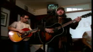 'Badly Drawn Boy' performing acoustic gig as Hargrave watches