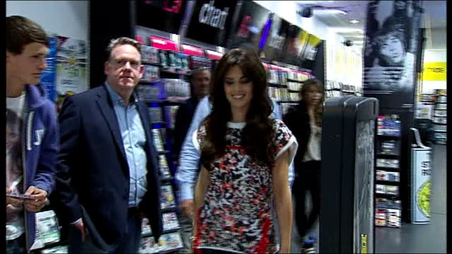 Cheryl Cole interview **FLASHLIGHT Cherly Cole walking through HMV record store and emerging onto shopping centre walkway where she waves to crwods...