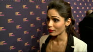 Chime for Change concert Backstage interviews ENGLAND London INT Chime for Change' logo / Freida Patel chatting to press / Freida Pinto interview SOT...
