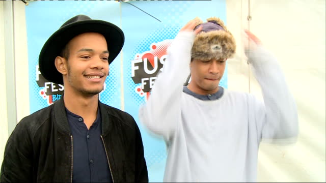 Fusion Festival backstage interviews EXT GVs Jordan 'Rizzle' Stephens Harley 'Sylvester' AlexanderSule among press outside tent Rizzle Kicks set up...