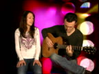 Jem interview and performance ENGLAND INT Jem performs song 'It's Amazing' accompanied by acoustic guitarist SOT