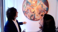 Ronnie Wood art exhibition and interview ENGLAND London General views of Ronnie Wood showing reporter around exhibition