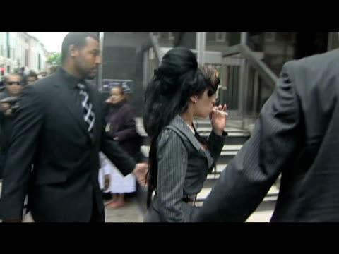 Pop star Amy Winehouse returns to court after having a cigarette break during her assault trail as police shield star from press 23 July 2009