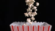 Popcorn falling into bag in super slow motion
