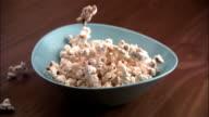 CU, SLO MO, Popcorn falling into bowl