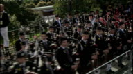 day one Pope and Queen speak at Holyrood Palace / Procession through Edinburgh ** Bagpipe music heard over the following shots SOT ** papal motorcade...
