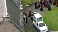 day one Pope and Queen speak at Holyrood Palace / Procession through Edinburgh AERIAL Pope children / AERIAL Pope along past Popemobile then into...