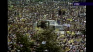 one week to go 1982 EXT Pope John Paul II along through crowds in Popemobile