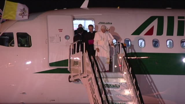 Pope Benedict XVl walks down aircraft steps after arriving at Heathrow for visit to Britain Greets various dignitaries including London Mayor Boris...