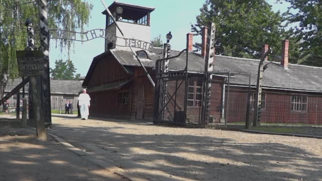Pope Francis on Friday walks alone through the notorious wroughtiron Arbeit Macht Frei gate as he visits the former Nazi death camp Auschwitz Birkenau