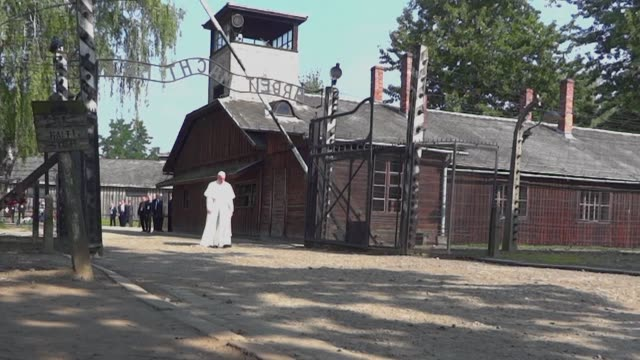 Pope Francis on Friday walks alone through the notorious wroughtiron Arbeit Macht Frei gate as he visits the former Nazi death camp AuschwitzBirkenau