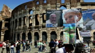 Pope Giovanni Paolo II and Pope Francis I merchandise under the Coliseum