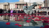 Poppies float in a fountain during an Armistice Day event in Trafalgar Square on November 11 2016 in London England The annual Armistice Day service...