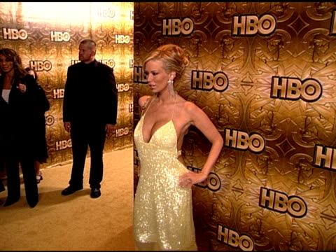 HANDHELD Pornographic actress and entrepreneur Jenna Jameson standing on carpet in Beverly Hilton hotel posing for photographs for press