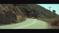 1966 WS  Porsche sports car driving down mountain road