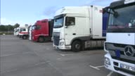 Port of Dover fears trade bottleneck after Brexit Near Dover Various of lorries parked at truck stop Vox pops SOT