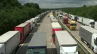Port of Dover fears trade bottleneck after Brexit R29071522 / 2972015 Various of lorries parked up on the M20 motorway during Operation Stack which...
