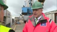 Port of Dover fears trade bottleneck after Brexit Tim Waggott interview SOT Crane lifting shipping container Crane loading shipping container onto...