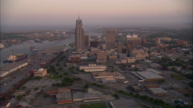 AERIAL Port of Mobile and downtown district wit RSA Battle House Tower at sunset, Mobile, Alabama, USA