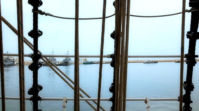 Port view through ship rigging