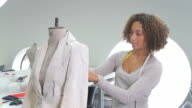 Portait of Female Fashion Designer working in studio