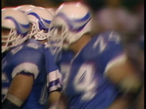 1985 MONTAGE MS Portland Breakers in huddle during game against Birmingham Stallions/ MS Quarterback Matt Robinson calling time out/ MS Breakers coach Dick Coury looking annoyed/ Portland, Oregon