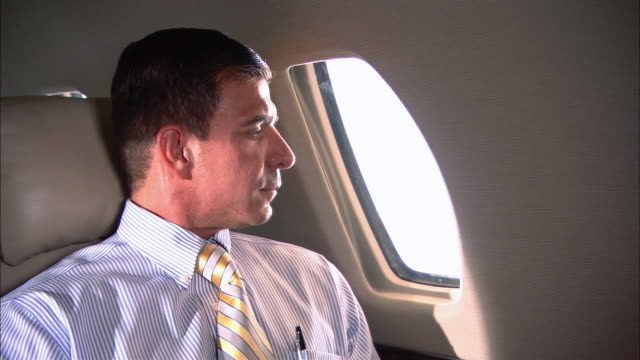 MS portrait businessman on corporate jet