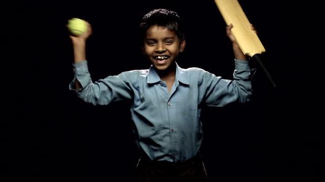 Portrait of a boy celebrating success