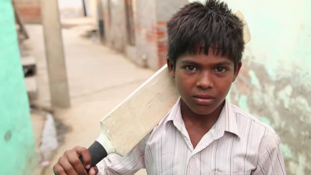 Portrait of a boy holding a cricket bat, Faridabad, Haryana, India