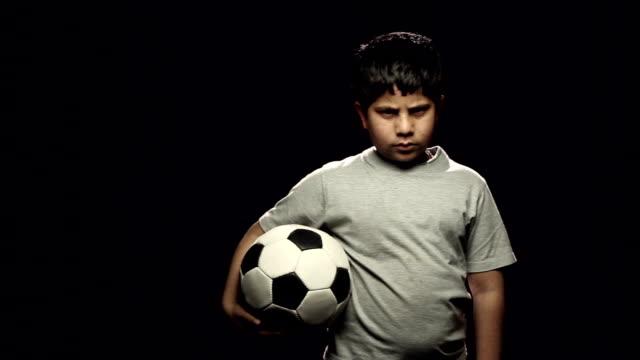 Portrait of a boy holding a soccer ball