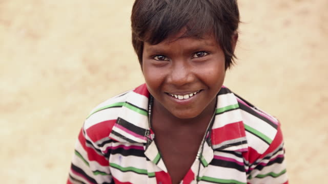 Portrait of a boy smiling, Haryana, India