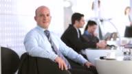 HD DOLLY: Portrait Of A Businessman At The Café
