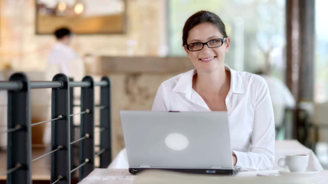 HD: Portrait Of A Businesswoman Using Laptop