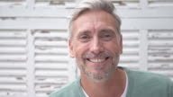 Portrait of a Caucasian mature man at home