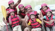 Portrait of a family cheering at river rafting