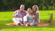 HD DOLLY: Portrait Of A Family Having Picnic