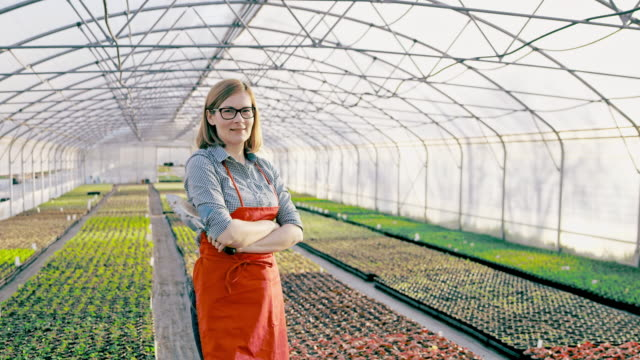 DS Portrait of a female florist in the greenhouse