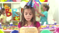 HD DOLLY: Portrait Of A Girl Blowing Birthday Candles