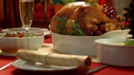 Portrait of a golden and crisp turkey on a Christmas table