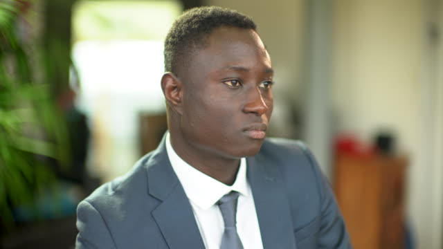 A portrait of a hansom black man wearing a smart suit.