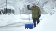 HD: Portrait Of A Man Shoveling The Snow