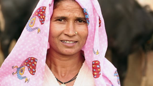 Portrait of a mature woman smiling, Ballabhgarh, Haryana, India