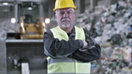 SLO MO portrait of a recycling facility worker