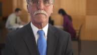 HD: Portrait Of A Senior Businessman