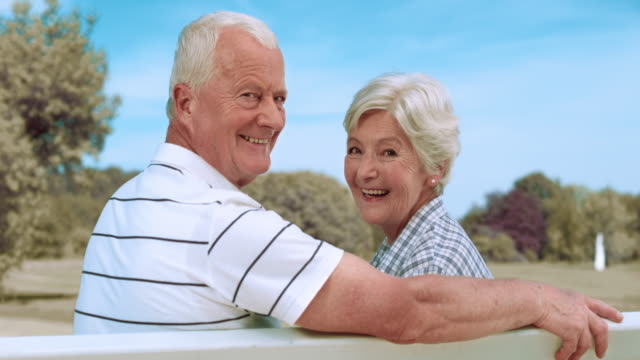 SLO MO Portrait of a senior couple sitting on a park bench