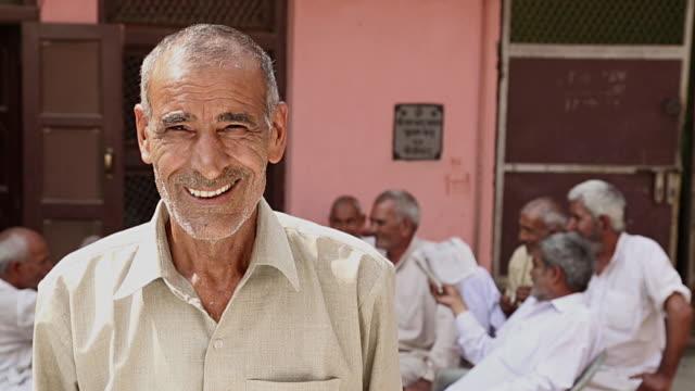 Portrait of a senior man smiling, Haryana, India