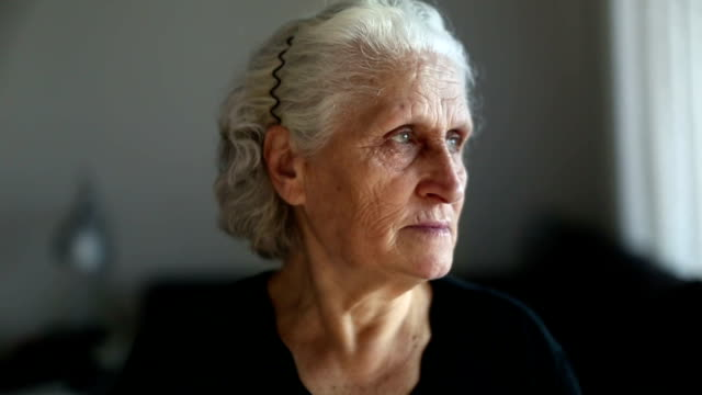 Portrait of a senior woman looking around