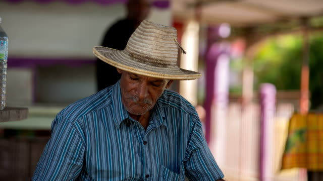 Portrait of a very old Caribbean market vendor at the market of St. Anne, Martinique, West Indies