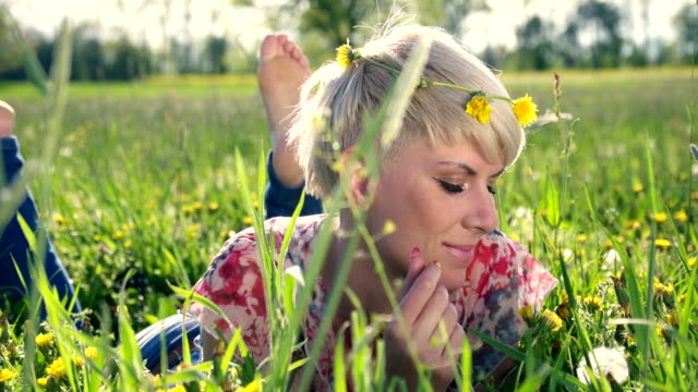 HD DOLLY: Portrait Of A Woman Blowing Dandelion