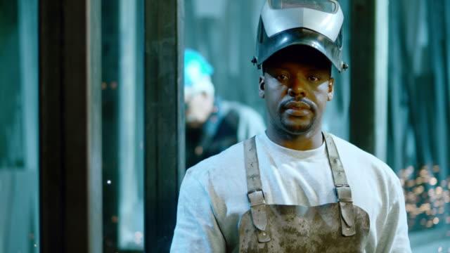 SLO MO DS Portrait of a worker in metal workshop